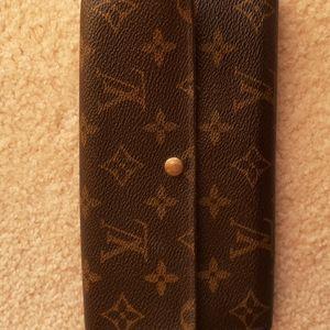 "Louis vuitton vintage  wallet...3 pockets,2 card pockets..7.25"" Length Authentic"